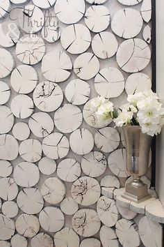 Love this wood slice wall - a large framed piece? Or the new rustic board and batten treatment?
