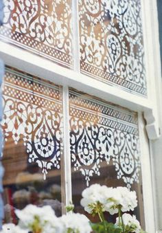 I love this window stencil idea -so much prettier than old dust-gathering nets! The stencils are from Stencil Library.com