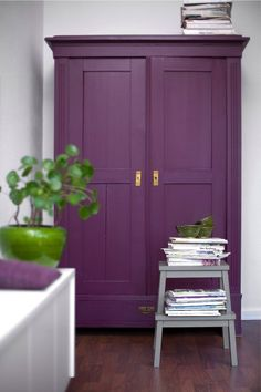 Inspired: Deep orchid doors, grey trim (from the stool) bright green (from the pot) for the INSIDE of the beam trim, and of course brass hardware.