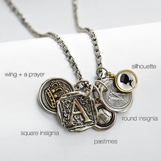 round insignia charm necklace - silver with initials for kids plus other charms.