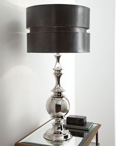 """$299    Tall metal lamp with dimensional shade sets the stage for your contemporary decor. From the John-Richard Collection. Imported.  Handcrafted metal lamp has a hand-applied chrome finish polished to a mirror shine.  Chocolate faux snakeskin shade is backed with silver-toned paper.  Uses one 150-watt bulb.  16""""Dia. x 33.5""""T."""