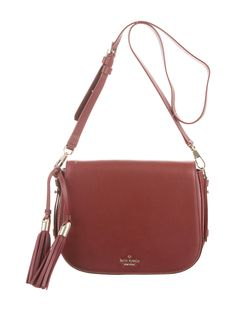 Burgundy leather Kate Spade New York Chepstow Road Elliot Bag with light gold-tone hardware, single adjustable shoulder strap, tassel embellishment at side, black woven lining, three pockets at interior walls; one with zip closure and flap with magnetic snap closure at front. Includes dust bag. Shop authentic designer handbags by Kate Spade New York at The RealReal.