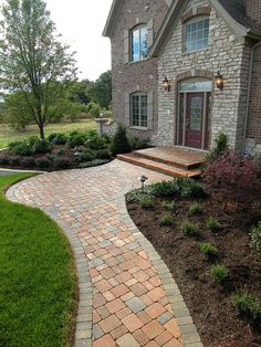 Block front walkway with interesting shape. A little ornate for my house, but maybe on a smaller scale. Love this with one or possibly two raised edges!