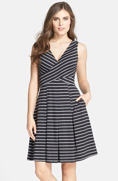 Free shipping and returns on Donna Morgan Stripe Ponte V-Neck Fit & Flare Dress at Nordstrom.com. Crisp stripes accentuate the crisscrossed bodice of this feminine ponte dress finished with a pleated, flared skirt.