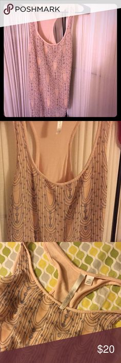 Lauren Conrad tank Peach in color, gray design on front. Top part of shirt is shear.. Loose fitting Lauren Conrad Tops Tank Tops