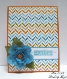 HA Tweed Pattern embossed in white with spaces colored in with distress markers