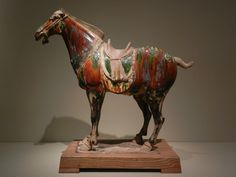 Caparisoned horse Shaanxi or Henan province, China Tang dynasty (618-906), 675-750 Molded and sculpted earthenware with sancai (three color) glaze Portland Art Museum