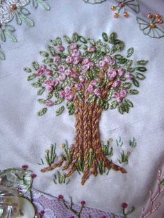 Embroidery on a Crazy Quilt Block....would be so pretty on a baby girl's quilt.