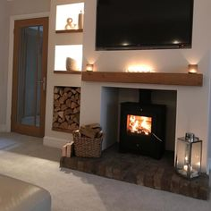 Summer might be nearly over but I am looking forward to cosy nights back in front of the fire Oak Beam Fireplace, Log Burner Fireplace, Living Room With Fireplace, Home Living Room, Electric Log Burner, Cottage Lounge, Log Store, Lounge Decor, Lounge Ideas