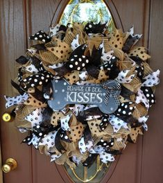 "Brighten your Front Door with this ""Dog Lovers Wreath"" made with: Polyester Faux Burlap Ruffle technique, accented with paw print ribbon, glitter ribbon, burlap and black ribbon, black and white dot ribbon and a bone shaped welcome sign that says ""Beware of Dog Kisses"". Welcome Your Guests by showing them your love of Dogs.  This wreath is a large 26"" in diameter and needs to be hung under a covered area such as a porch or overhang. This white ribbons will stain in bad weather so it would be…"