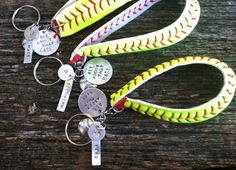 "Softball or baseball Keychains. Add on name & number. Handstamped Phrase ""All About that base"", keychain made from real softball or baseball by RusticPickns on Etsy"