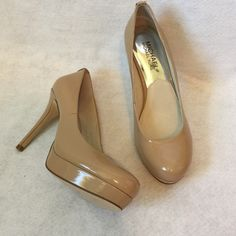 """NEW!  MICHAEL KORS   The perfect heel! ❤️ Michael Kors.  Nude color  with  silver MK accent on heel.  Platform for comfort. 4 inch heel.  A """"must have"""" shoe. Michael Kors Shoes Heels"""
