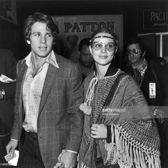Married American actors Leigh Taylor-Young and Ryan O'Neal attend the premiere of the film, 'Patton', at Pantages Theatre, Hollywood, 18th February 1970. Taylor-Young wears a poncho and headband, and O'Neal wears a plaid sports jacket.