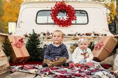 My Christmas Mini session 2016! Christmas items in the back of an old truck with kids, bright wreath! Loved it this year!
