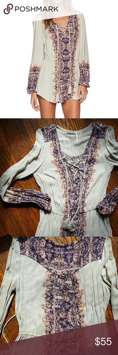 Free People wildest moments tunic Free People wildest moments tunic. Cream and purple color. Faltering fit. Lace up with tassels. Some light wear on tassels. Also I used the first photo to show fit. Definitely not a dress, but top/tunic.  Comment with any questions. No trades. Open to reasonable offers. Thanks! Free People Tops