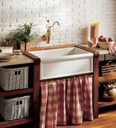 i know it's not practical, but i can't get enough of farmhouse sinks with curtains underneath. this would even be sweet in a garage or shed for gardening.