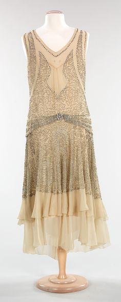"~Evening Dress: ca. 1928–1930, American, silk, rhinestones. ""...Perhaps what makes this dress so interesting is its adornment. The placement of the rhinestones adds dimension to the vermiculate pattern while the negative space patterning has a Middle Eastern feel. Additionally, the trompe l'oeil belt is not only unique, but eye-catching, drawing attention to the waist.""~"