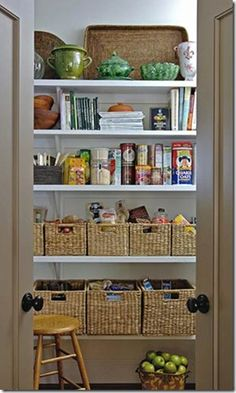 Pantry- love how they organized messy looking items like snack foods into pretty baskets of uniform size.