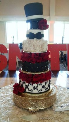 Black and red wedding cake. Tiered Wedding Cake. Red Rose. Wedding Planning. Red and Black theme.