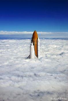 Space Shuttle Through Clouds