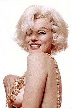 """Marilyn Monroe's famous """"Last Sitting"""" photos have become iconic images of the celebrated starlet, and Lindsay Lohan's Vanity Fair photo shoot aimed to honor the legendary shots."""