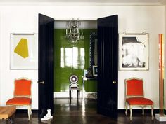 Blowin' in the wind.................. Love the black doors, pops of colour, laquered wall.
