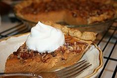 Southern Sweet Potato Pie - A classic southern pie made with spiced fresh sweet potatoes, topped with toasted pecans and drizzled with syrup.