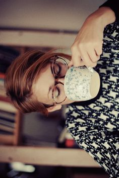 Love her hair color, and the specs, and the mug, and sweater. Basically everything about this photo is awesome.