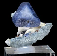 Benitoite -  is a rare blue barium titanium silicate mineral, found in hydrothermally altered serpentinite.  Item no. 7472  Dallas/Benitoite Gem Mine  San Benito County  California  USA