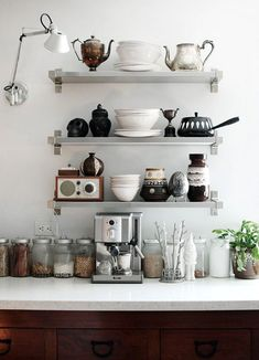 Easy to put up these shelves are both useful and decorative - like the anglepoise lamp up high like this.