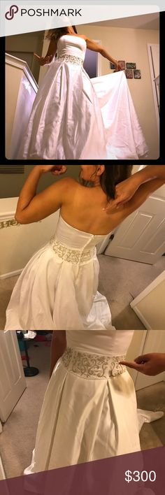 Christina Collection Wedding Dress Classic and clean style wedding dress. Never worn down the aisle, bought from Eva's Bridal. Gold embroidery at waist, medium length train. Size 10, fits closer to size 8 Christina Collection Dresses Wedding