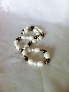 Vintage white glass silver and copper toned beads by Comforte, $10.00