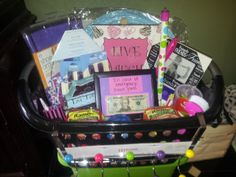 """""""Off to college"""" gift basket - includes fold up hamper, picture frames, emergency kit, flower-patterned tool kit, plunger, show organizer, over-the-door hooks, ramen noodles, shower caddy, """"hangover"""" kit, piggy bank (with cash in it, of course), dishes, etc. etc. in a laundry basket that they can take with them!"""