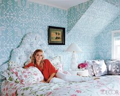 Veronica Beard's Hampton's home. Linens by D. Porthault. Wallpaper and headboard fabric by Quadrille.