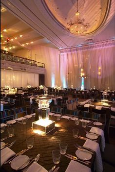 HUGE fan of square tables! Makes interaction and conversation amongst more guests much easier and less awkward! Corporate Event Decor