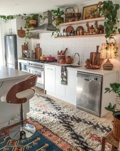 Here we are going to offer you the stylish idea for the proper bohemian style adornment of your kitchen area. Each and everything of the kitchen use is so perfectly arranged that is giving this area a neat and clean appearance. We have added plants with pots to make the kitchen area looks fresh.