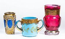 ASSORTED BOHEMIAN TOOTHPICK HOLDERS, LOT OF THREE; comprising an opaline example with gilt and polychrome-enamel decoration, possibly Moser, a colorless with gilt decoration and blue-staining, and a signed Moser cased cranberry / COST $184.00
