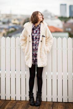 Model / Cecil Kishimoto. Check mini dress and white far coat. Natural hair style. Cute fashion by Image.