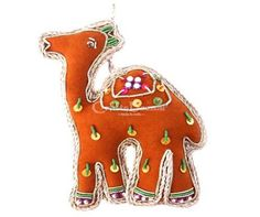 Some boys and girls have a complete attraction with the animal kingdom, whereas others simply love the idea of a cloth toy to cuddle at bed time. This is a beautifully decorated orange Camel Hanging Animal Toy for children or for Room Decoration Gift Plush material, comfy and can be hung on the wall. It is a beautifully decorated with multicolored beads and sequins, could set it in kid's room. #artsandcrafts #craftsofindia #indianheritage #handmade #craftsbazaar #madeinindia #artisansonline