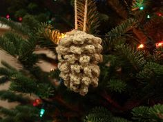 Instead of going out into the yard to collect pine cones, grab your crochet hooks and yarn. This gorgeous Crocheted Pine Cone DIY Ornament is a unique version of pine cone decorations, but will look even prettier on your tree. Crochet Christmas Decorations, Christmas Crochet Patterns, Holiday Crochet, Christmas Crafts, Homemade Christmas, Christmas Christmas, Crochet Diy, Crochet Home, Crochet Crafts
