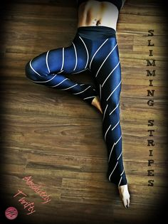 """Absolutely Thrifty's """"Slimming Stripes""""- Yoga Leggings Leggings, Beanies, and Scarves. Go from Yoga to dinner in our body hugging printed leggings. Compression fit performance fabric milled in Montreal. Made to last, our fabric won't lose shape and our vibrant prints never fade. Opaque, safe to wear for working out. #yoga #leggings #yogapants #capris #activewear #gymwear #fitness #workoutclothes #northamerican #womensfashion #originaldesign #spandex #polyester #black #yellow #pattern #lines"""