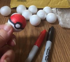Make tiny Pokemon balls with styrofoam balls or ping pong balls and sharpie markers