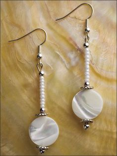 "White is essential and goes with everything. Beautiful coin shell beads are stunning with a dash of small beads and shining silver. This e-pattern was originally published in Earrings, Earrings, Earrings! Size: 2 1/2"" long. Skill Level: Easy"