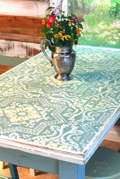 Great tutorial on transforming a table --chalk painted, stenciled and distressed