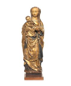An early 16th century Malines polychrome and parcel gilt carved wood figural group of the Virgin and Christ Child