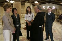 Laura Bush talks with Father Michele Piccirillo, head of the Franciscan Archeology Society, Chief of Staff Anita McBride, second on left, and Queen Rania al-Abdullah, center, in the Basillica on top of Mount Nebo in Jordan Saturday, May 21, 2005.