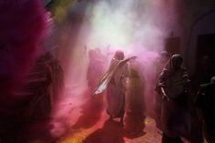 ndian Hindu widows play with colored powder as a part of Holi celebrations at the Pagal Baba Ashram in Vrindavan, India, on March 15. The widows, many of whom at times have lived desperate lives in the streets of the temple town, celebrated the festival at the ashram. After their husband's deaths the women have been banished by their families to the town where devotees believe Lord Krishna was born, for supposedly bringing bad luck. (Rajesh Kumar Singh/Associated Press)