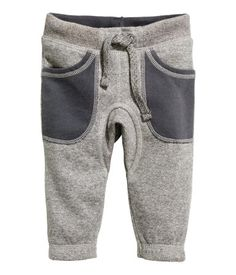 Sweatpants with elasticized drawstring waistband, front pockets, and elasticized hems. Soft, brushed inside.