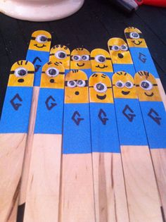 Minion pointers. Popsicle sticks, highlighter, and painter's tape. Possibly tape all the way down and write student names on the tape so they can be reused several years.
