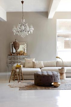 living room ideas - taupe wall with crystal chandelier